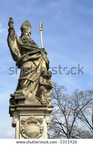A statue at the Charles Bridge in Prague, Europe. - stock photo