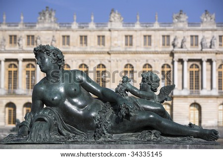 A statue in garden of Versailles, the famous palace of the Sun King: Louis XIV. - stock photo