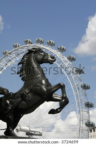 A statue of a horse framed in the London Eye. - stock photo
