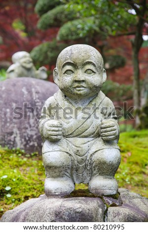 A statue of a monk in Japanese garden