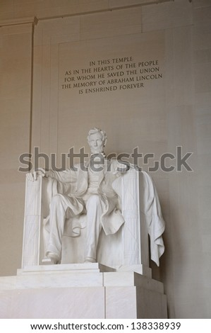 A statue of Abraham Lincoln inside of the Lincoln Memorial in Washington DC