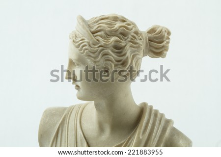 A statue of Diana, Roman goddess, the daughter of Jupiter and Latona and the twin sister of Apollo. In Roman Mythology she was the goddess of wild animals and the Hunt. - stock photo