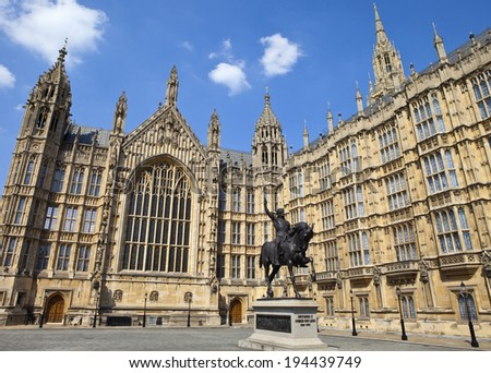 A statue of King Richard I (also known as Richard the Lionheart) outisde the Houses of Parliament in London. - stock photo