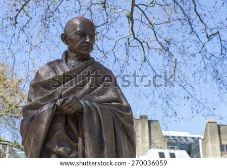 A statue of Mahatma Gandhi situated on Parliament Square in London. - stock photo