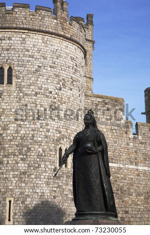 A statue of Queen Victoria in front of Windsor Castle. - stock photo