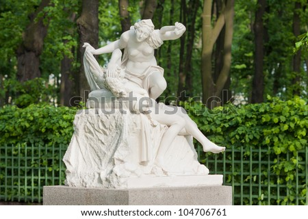 "A statue of the Summer Garden ""Youth"". Copy.  Unknown sculptor Italy, XVIII century. Old park ""Summer Garden"" in St. Petersburg, Russia"