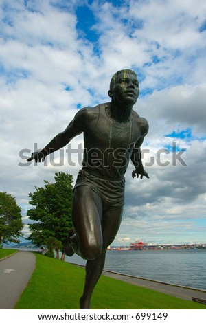 a statue: running and pursuing man - stock photo