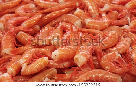 A steamed tail on shrimps background in a fish market - stock photo