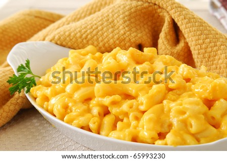 A steaming hot platter of macaroni and cheese - stock photo