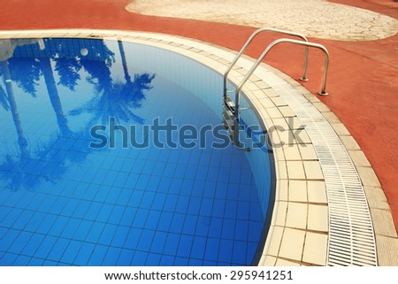 a steps in blue water pool - stock photo
