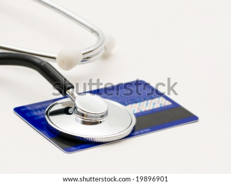 A stethoscope by a Credit card payment - stock photo