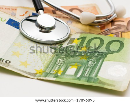 A stethoscope by cash money - stock photo