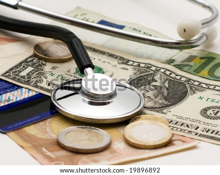 A stethoscope by  money and credit card - stock photo