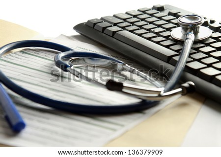 A  stethoscope on a laptop computer - stock photo