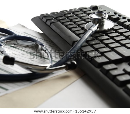 A stethoscope on a laptop computer