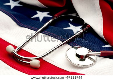 A stethoscope on an American flag: Health Care debate - stock photo