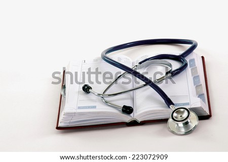 A stethoscope on an organizer - stock photo