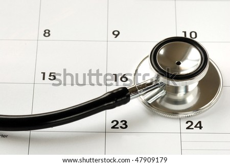 A stethoscope on the calendar concepts of medical appointment - stock photo