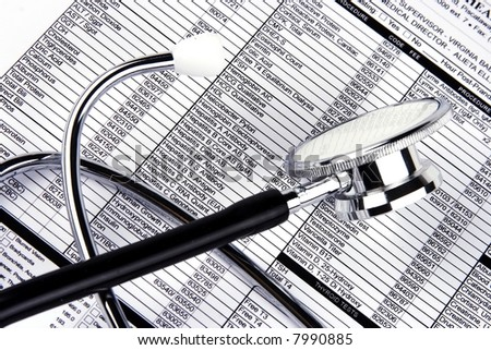 A Stethoscope over a medical report form. - stock photo