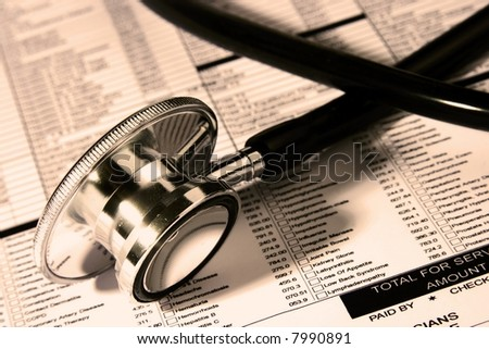 A Stethoscope over a medical report in Sephia color - stock photo