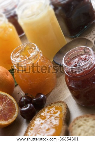A still life of fruit jam on a table - stock photo