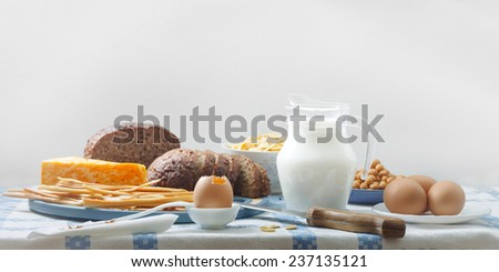 a still life with eggs, milk, and cheese