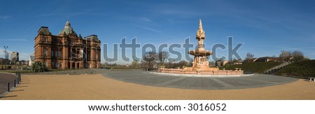 A stitched panorama of six photographs of the People's Palace Museum and the Doulton Fountain, Glasgow Green , Scotland - stock photo