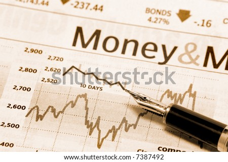 a stock market chart with a nice pen - stock photo
