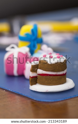 A stock photo of a tiny cake and presents made from fondant - stock photo