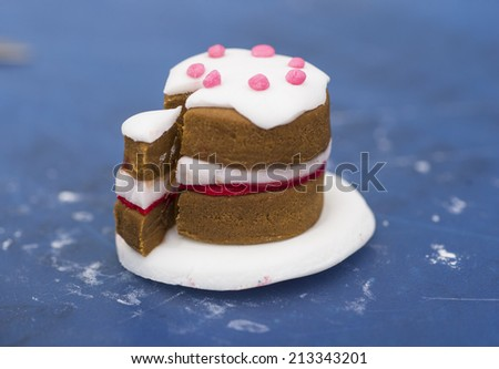 A stock photo of a tiny cake made from fondant - stock photo