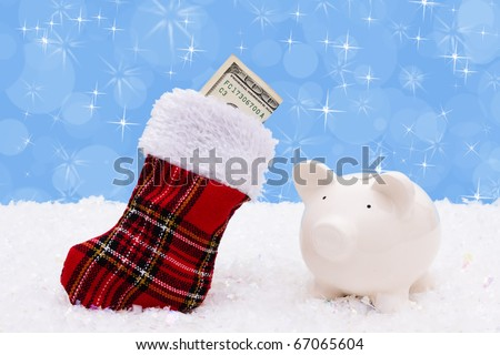 A stocking with a one hundred dollar bill on a snow background, Christmas Time - stock photo