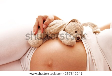 a stomach pregnant woman on white background - stock photo