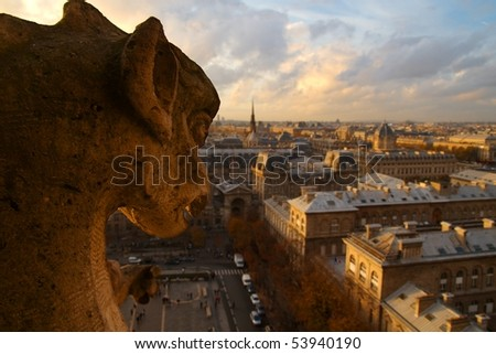 A Stone Grotesque (Gargoyle) of Notre Dame looks down on Paris, France