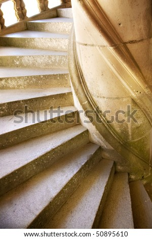 A stone, spiral staircase from a castle in France - stock photo