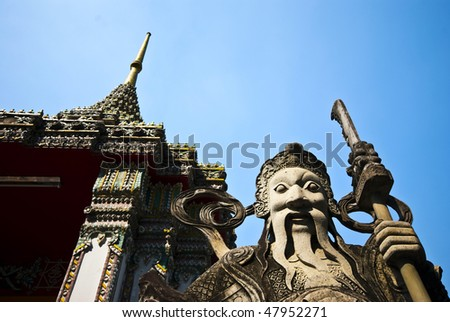 A stone statue at a temple in Bangkok, Thailand