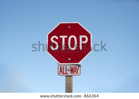 "A stop sign with an ""All-Way"" sign below it set against a blue sky."
