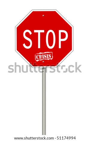A stop sign with the text Crisis where the last word looks spray painted.