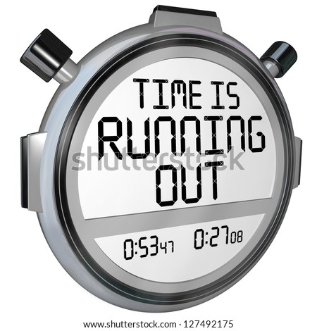 A stopwatch or timer with the words Time is Running Out to warn you that the clock is ticking and the deadline or finish point is near and you should hurry or speed up to complete the game or job - stock photo