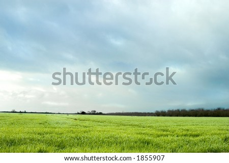 A storm approches a farm. - stock photo