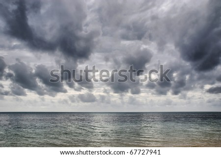 a storm builds up over the Coral Sea near Green Island, North Queensland, Australia - stock photo