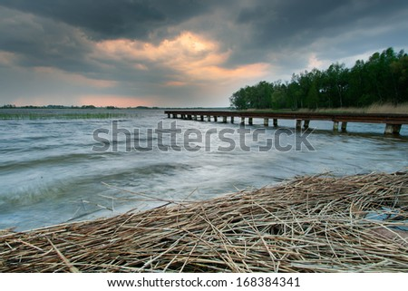 A storm comes on the lake - stock photo