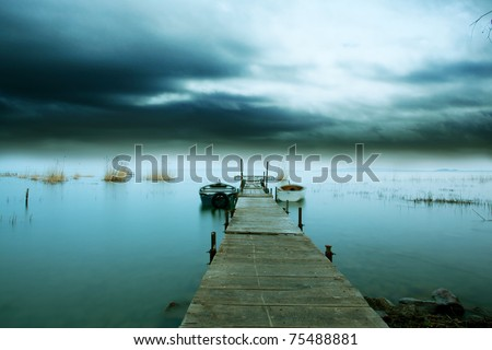 A storm comes on the lake night - stock photo