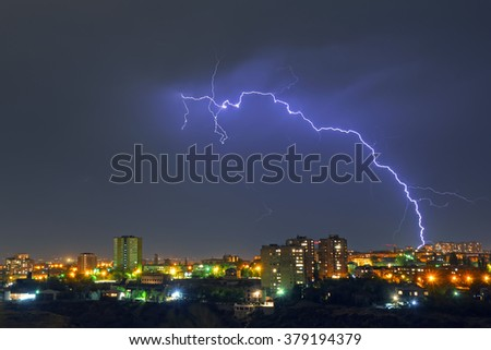 a storm with lightening in the night city - stock photo