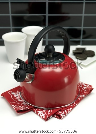 A stove top kettle on a kitchen bench