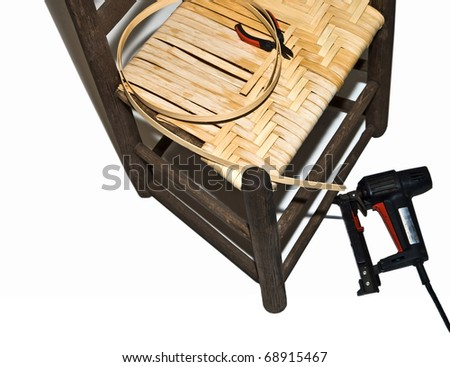 A straight chair being re-caned with a style called split oak, in a herringbone pattern, one of many different types of cottage industries or home craft businesses. - stock photo