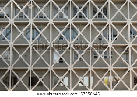 A straight flat view of an apartment building with windows. - stock photo