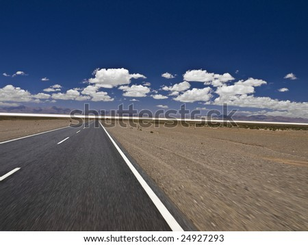 A straight road to the salt mine. Blurred by the motion. - stock photo
