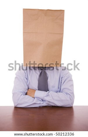A strange business man with a cardboard bag on his head - stock photo