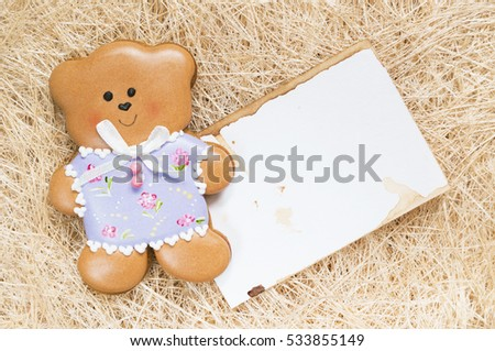 A straw background with a handmade honey-cake bear and a place for your text for a baby shower party, a birthday party or other events.