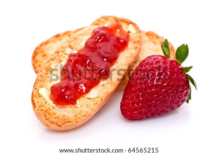 A strawberry and jam on bread.
